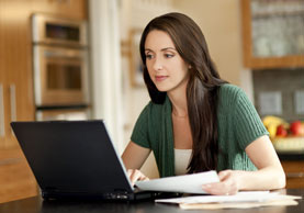Woman on computer managing her online account.